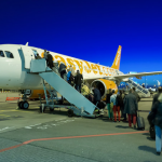 Migrant boarding plane